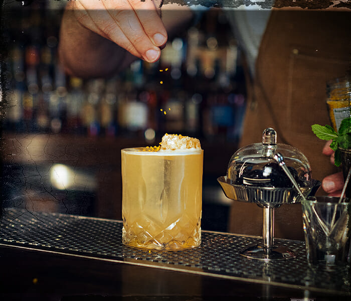 gold rush cocktail being served