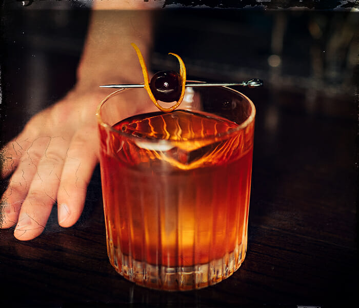old fashioned cocktail being served