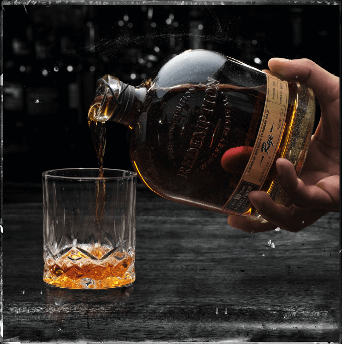 whiskey pouring into glass