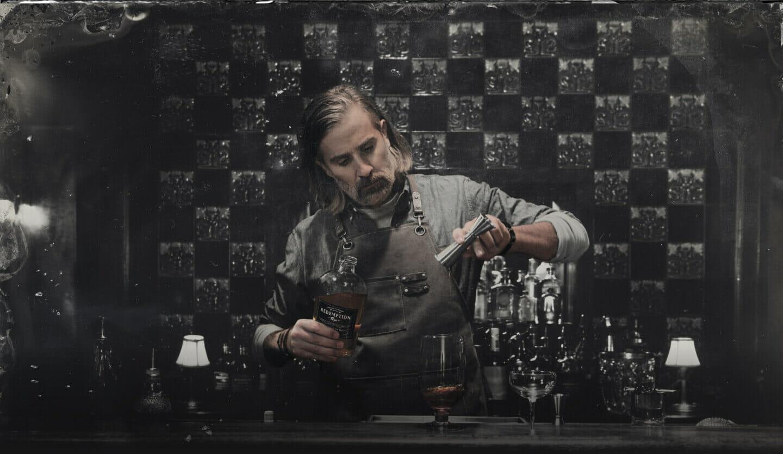 bartender mixing drink at a bar