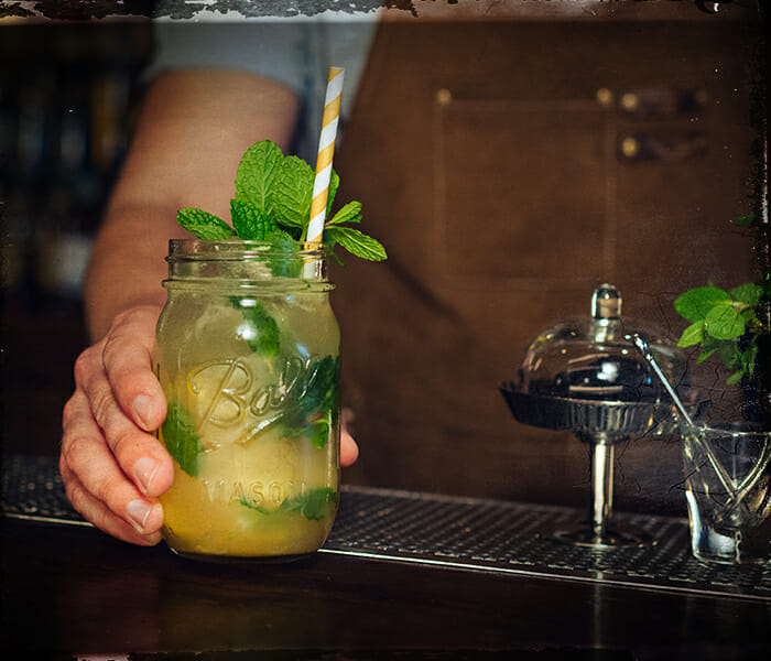 bartender pouring mixed drink